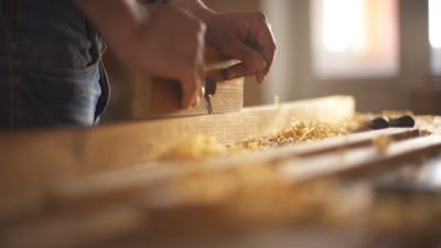 The Carpenter Sweeps the Shavings Off the Wood with Wood.