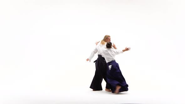Thumbnail for Man and Woman in White Keikogi Showing Aikido Techniques, Isolated on White