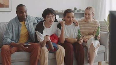 Happy Friends Sitting on Sofa