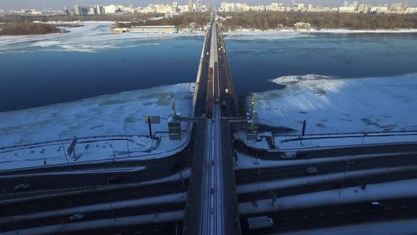 Thumbnail for Car on Bridge Across Winter River. Aerial View Subway Train Moving in City