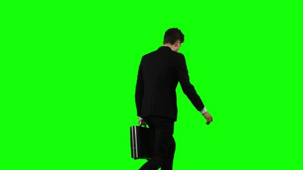 Thumbnail for Businessman Holds a Briefcase in His Hand, He Rushes Over It. Green Screen