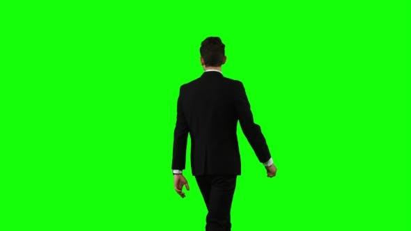 Thumbnail for Man Is Going To a Business Meeting and Waving Greetings. Green Screen
