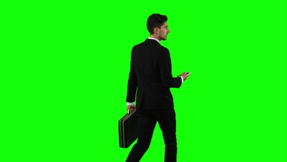Thumbnail for Businessman Is a Diplomat, a Telephone Rings To Him and He Talks. Green Screen