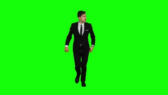 Thumbnail for Man Is a Telephone Rings To Him and He Talks. Green Screen