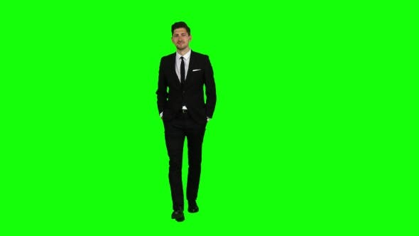 Thumbnail for Man Is Going To a Meeting and Waving Greetings. Green Screen