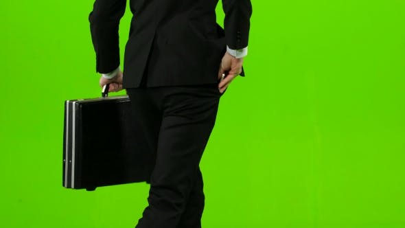 Thumbnail for Businessman He Has a Diplomat in His Hands, the Phone Rings and He Starts To Run. Green Screen. Back