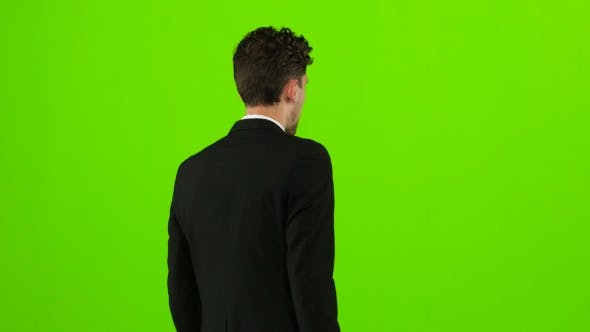 Thumbnail for Businessman Goes To Work, with a Diplomat He Waves His Hand To Others. Green Screen
