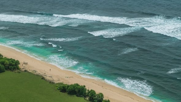 Moving Waves on Nunggalan Beach Coastline, Uluwatu, Bali, Indonesia