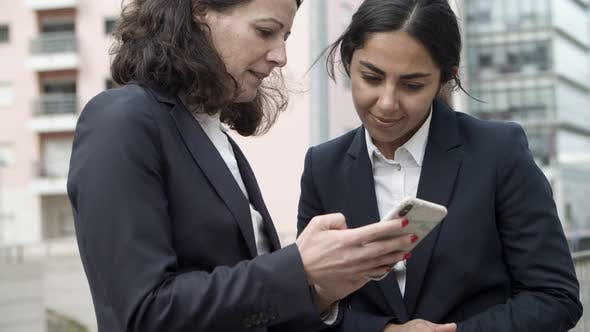 Thumbnail for Concentrated Businesswomen Using Smartphone