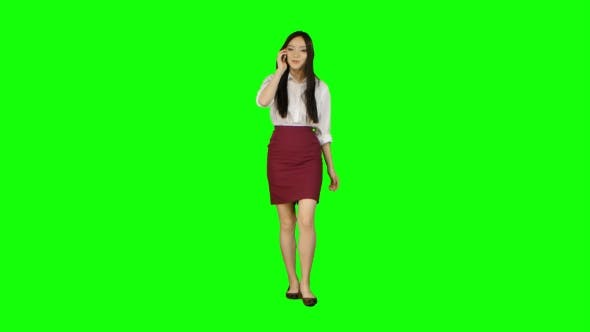 Thumbnail for Manager Girl Goes To Her Phone Rings and She Starts Talking. Green Screen