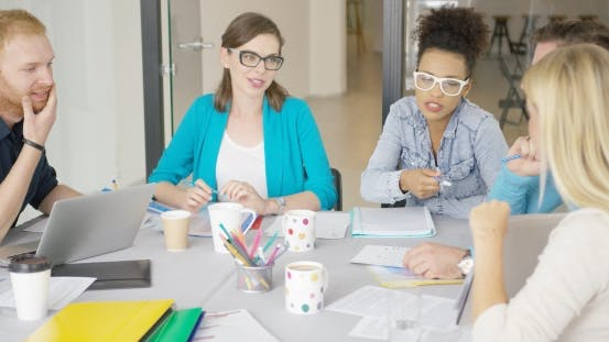 Thumbnail for Young Women and Men Working in Office
