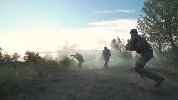 Military Forces Walking on Battlefield