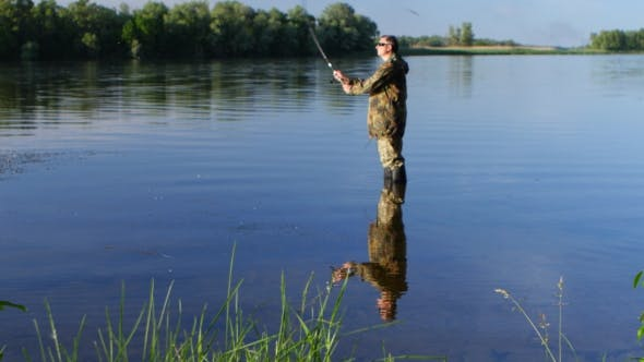 Thumbnail for Fisherman Enjoys Outdoor Recreation, Fishing for Spinning and Enjoying His Catch