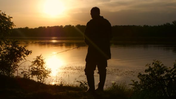Thumbnail for Man Spends His Leisure in Nature and Fishes at Sunset