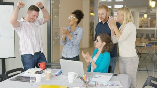 Cheerful Coworkers Celebrating