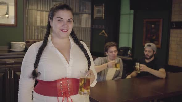 Thumbnail for Plump Woman with Pigtails in White Blouse and Corset Holding Beer Glass Looking Towards Two Men