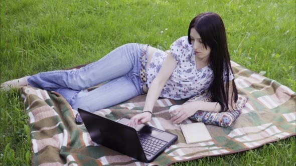 Thumbnail for Woman Student Using Laptop in Park