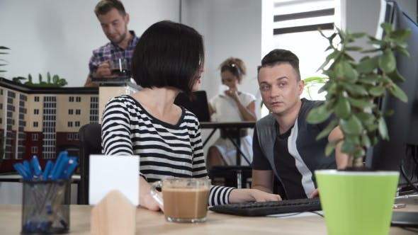 Thumbnail for Man and Woman Discussing in Front of Computer