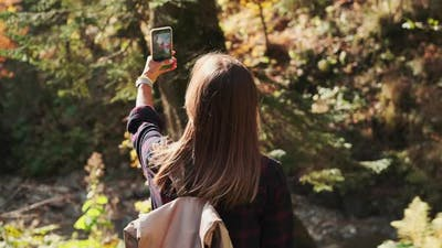 Hiker is Photographing Nature By Smartphone