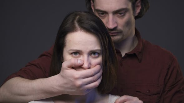 Domestic Violence, Man Closing Woman's Mouth by the Hand