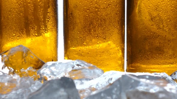 Thumbnail for Ice Lies on the Table, Behind It Are Bottles of Beer. White Background.
