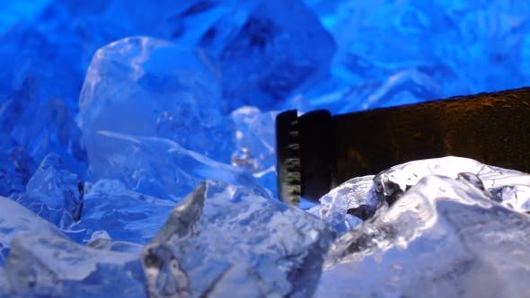 Thumbnail for Bottle of Beer in the Ice, Like Crystals, Drops of Condensate Fall Down the Glass.