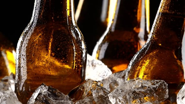 Thumbnail for Beer Festival, Bottles Stand in Pieces of Ice. Black Background. Silhouette.
