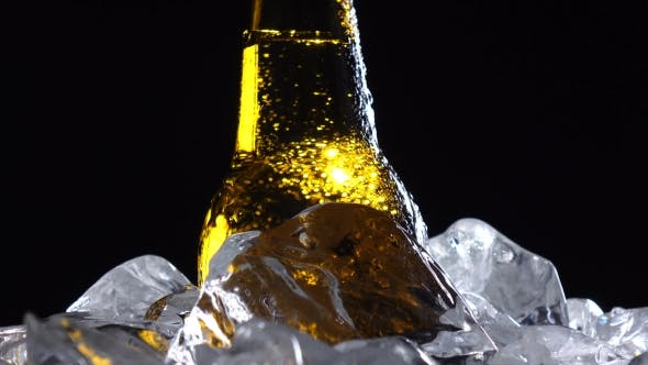Thumbnail for Condensate Flows Down the Brown Glass of Bottle From Beer. Black Background.