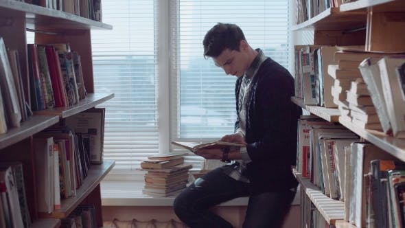 Thumbnail for Thoughtful Young Man Looking Through Books