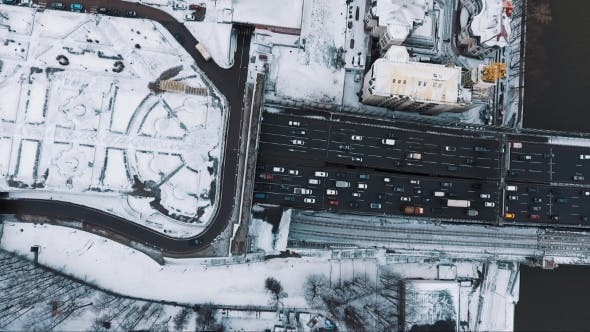 Thumbnail for Aerial Top View Car Road City Traffic Near Living Houses Area Cvered in Snow