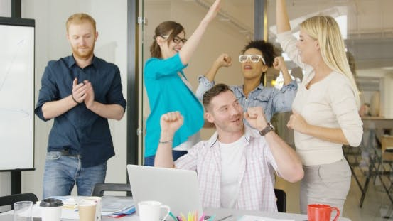 Thumbnail for Coworkers Celebrating Victory in Office