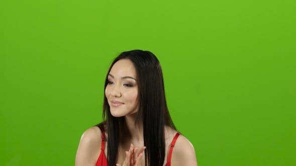 Thumbnail for Girl Came To the Store for Shopping and Can Not Choose Clothes. Green Screen