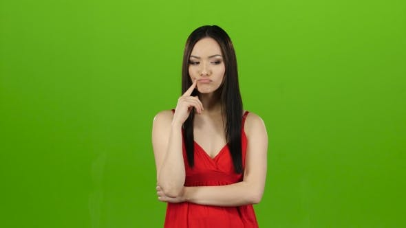 Thumbnail for Asian Thought About the Meaning of Life, Pensive and Focused. Green Screen
