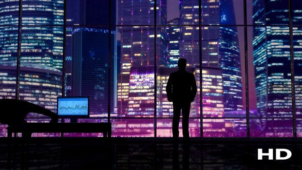 Thumbnail for Businessman In An Office On A Background Of Night Skyscrapers