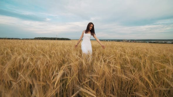 Thumbnail for Happiness, Nature, Summer Holidays, Vacation and People Concept - Young Woman in White Dress Walking
