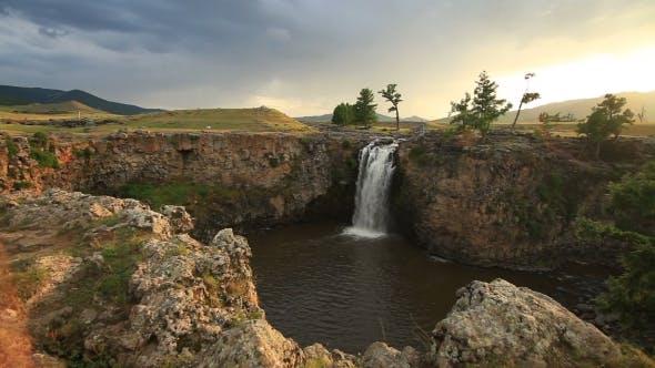 Thumbnail for Sunset Over Waterfall Ulaan Tsutgalan, Mongolia.