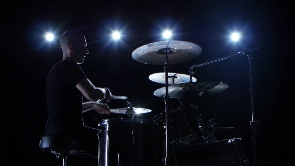 Thumbnail for Musician Plays Professionally Music on Drums. Black Background. Back Light. Silhouette