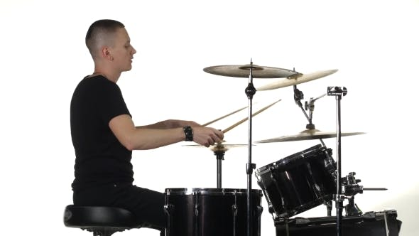Thumbnail for Young Man Professionally Plays Percussion Instruments . White Background