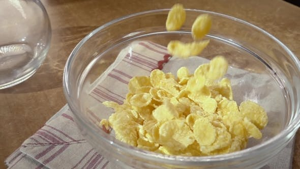 Thumbnail for Crispy Yellow Corn Flakes Into the Bowl