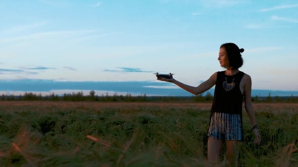 Cover Image for Pretty Girl in a Field with the Drone in the Field