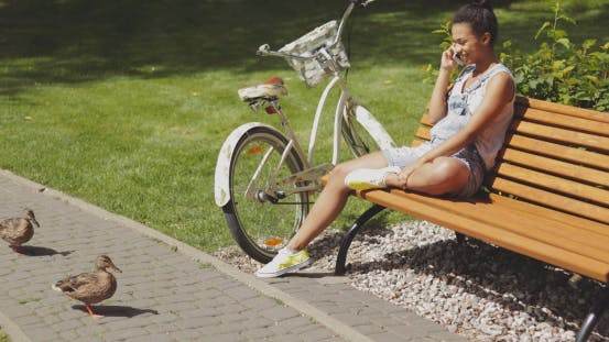 Thumbnail for Woman Talking Phone on Bench