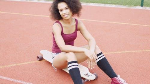 Confident Sportive Girl on Skateboard