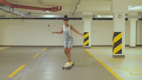 Thumbnail for Girl Skateboarding on Parking