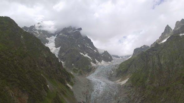 Thumbnail for Flying Over Glacier Valley in Svaneti Rocks. Snow Peak in Caucasus, Georgia