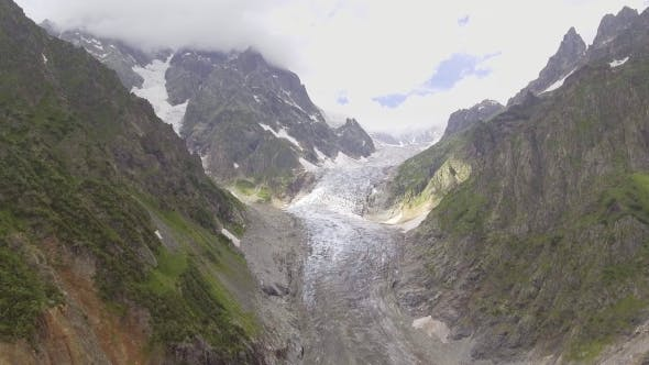 Thumbnail for Flying Over Glacier Valley in Svaneti Rocks. Snow Peak in Caucasus, Georgia.