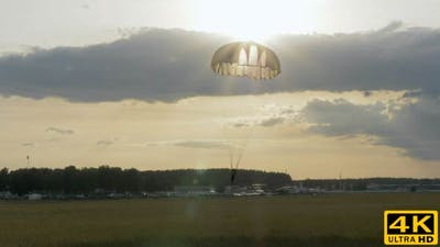 Skydiver Landing with Parachutes