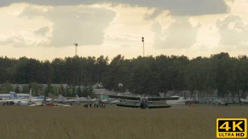 Parachutists Boarding To the Airplane