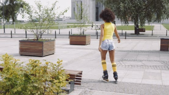Thumbnail for Anonymous Woman Roller Skating in Park