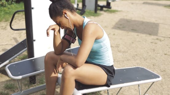 Thumbnail for Tired Sportswoman on Bench in Park