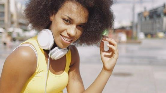 Thumbnail for Model in Headphones at Street